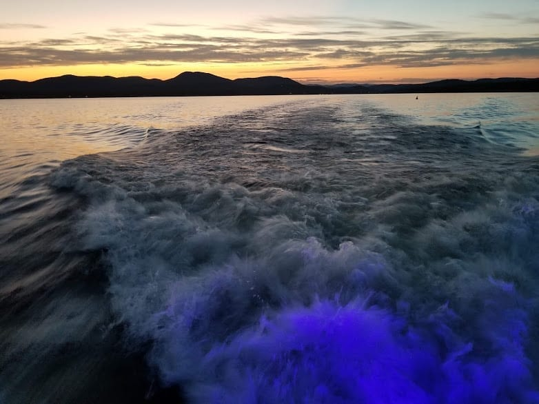 Sunset over the stern churning up water