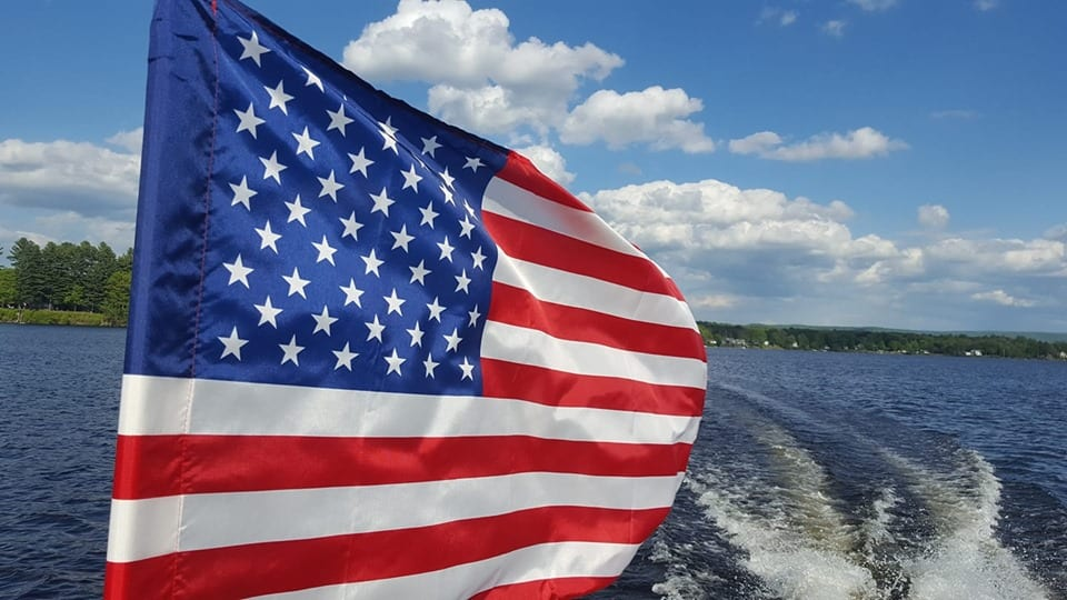 Flag on Running Boat
