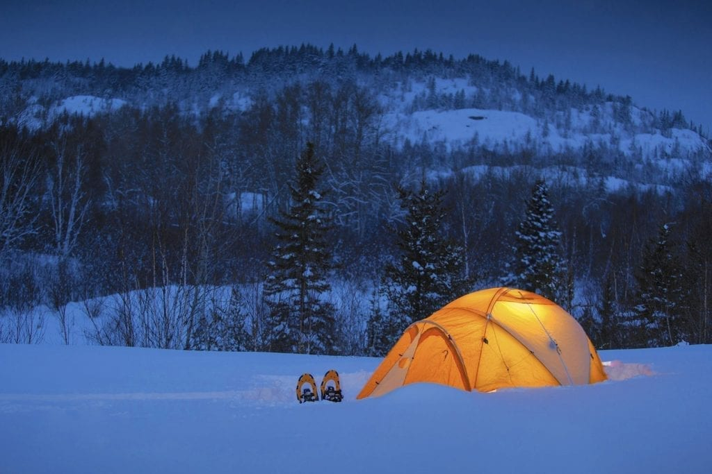 Tent with snowshoes embedded in the snowy landscape